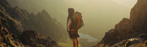 Investments Header Image - Back-packer in mountains