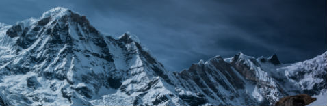 Actuarial Consulting Header Image - Snowy Mountain Range