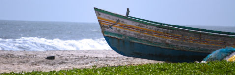 Total Renumeration Planning Header Image - Old Wooden Boat on beach
