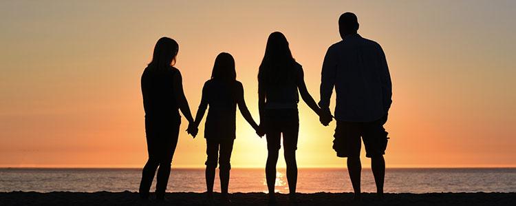 Family on the beach sunset