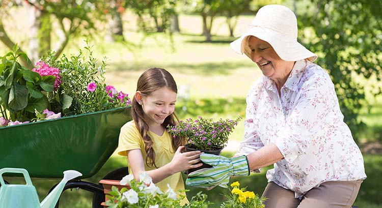 Grandmother and child in garden