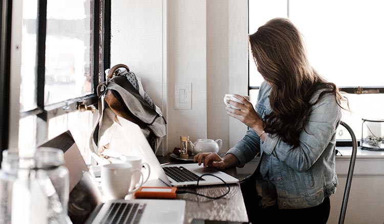 Woman at Cafe Desk Working